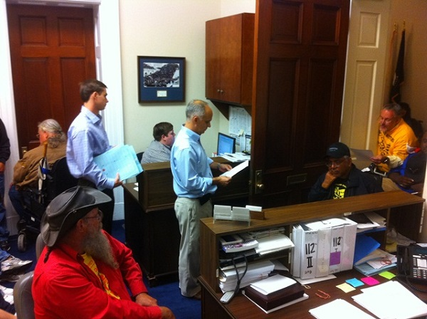4 persons in wheelchairs occupying a congressional office presentinga statement of demands