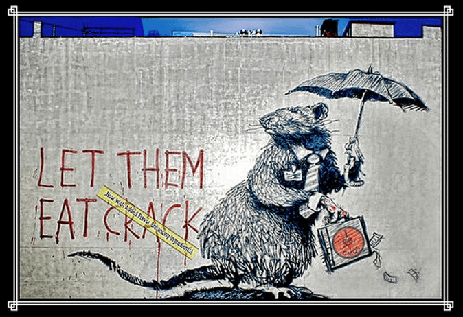 A concrete wall with a drawing of a rat holding an umbrella dressed in a tie and holding a briefcase with money falling out of it. On the wall is written, 'Let Them Eat Crack'