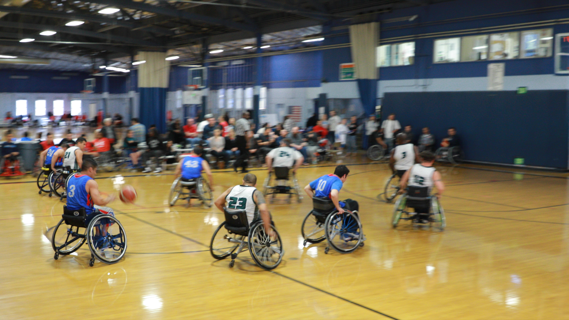 ASRA athletes playing wheel chair basketball.