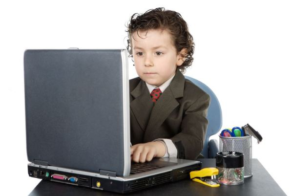 child with computer a over white background