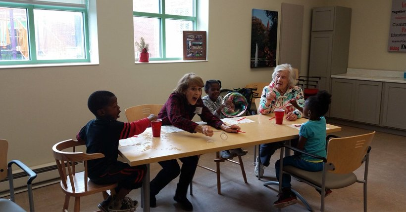 Children and Elders Playing with Bubbles - Champion Center