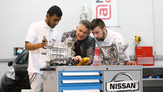 Trainee Nissan apprentices learning about electric vehicle technology as part of the Nissan Apprentice Academy