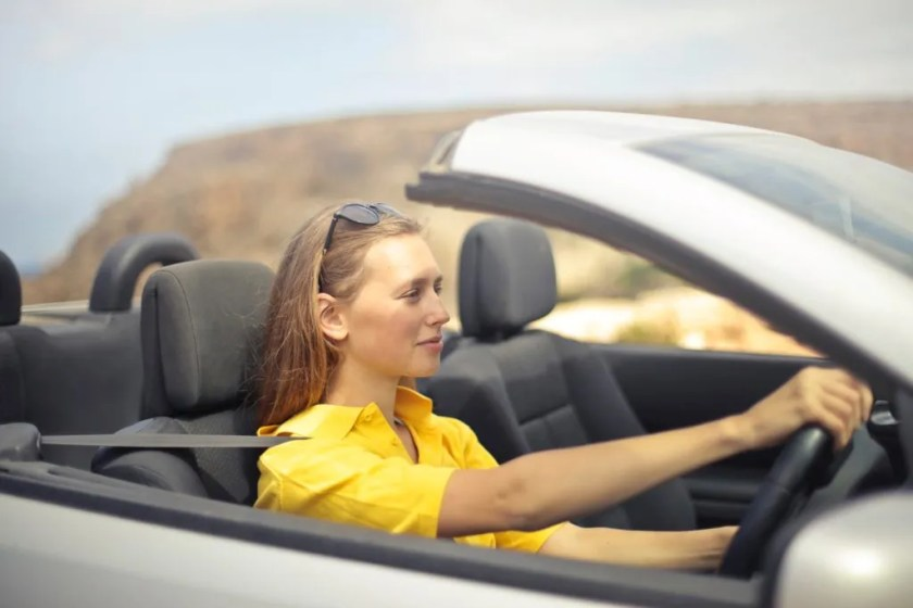 Woman driving car thinking about 182 offers!