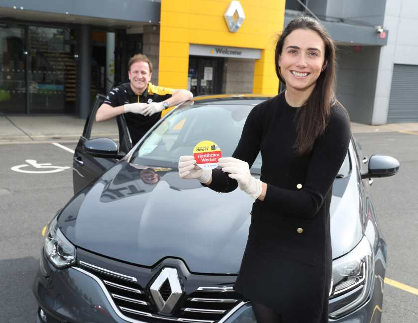 Sarah Kyne is photographed at a social distance with Richard Murphy of Renault Belgard collecting her Renault Mégane.