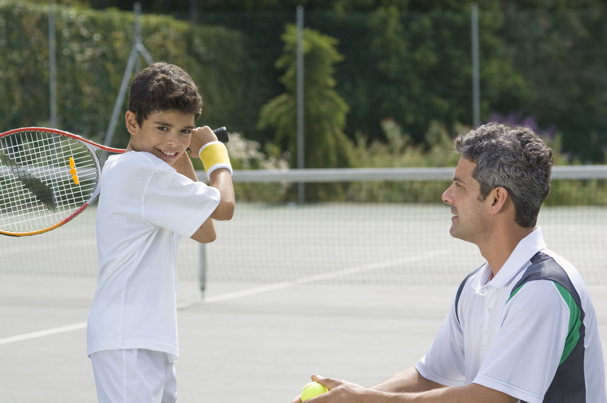 Image result for chennai father coaching his 10 year old son in tennis