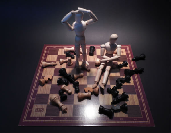 chessboard with stressed statues