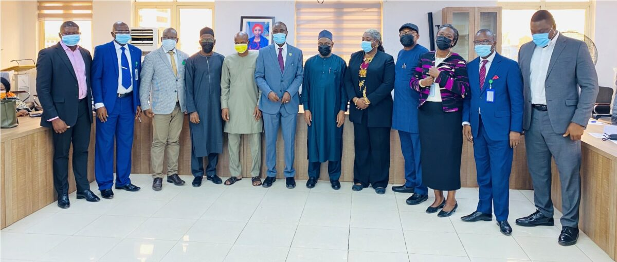 Members of the newly-inducted NPA-ACTU in a group photograph with the representative of the Acting Managing Director, NPA, Prof. Idris Abubakar (middle), and other