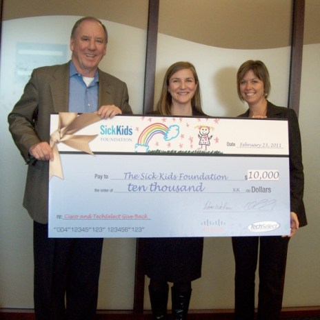 Rick Reid and Donna Wittmann present SickKids with a $10,000 cheque