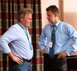 Kaspersky Lab founder and CEO Eugene Kaspersky (left) speaks with now-former CTO Nikolay Grebennikov at a 2011 analyst event.