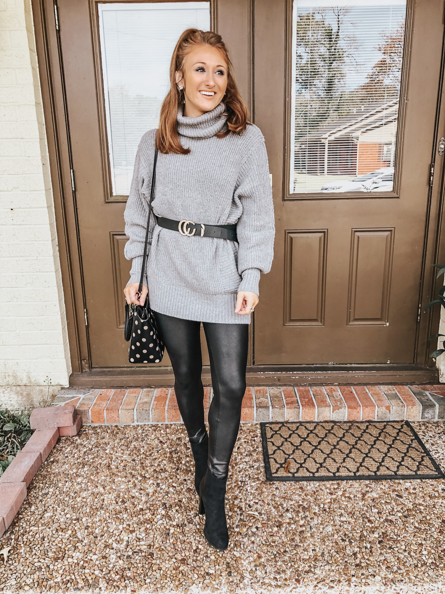 Carrington of Chaos and Coffee in a gray sweater dress, black faux Gucci belt, Spanx faux leather leggings and black booties