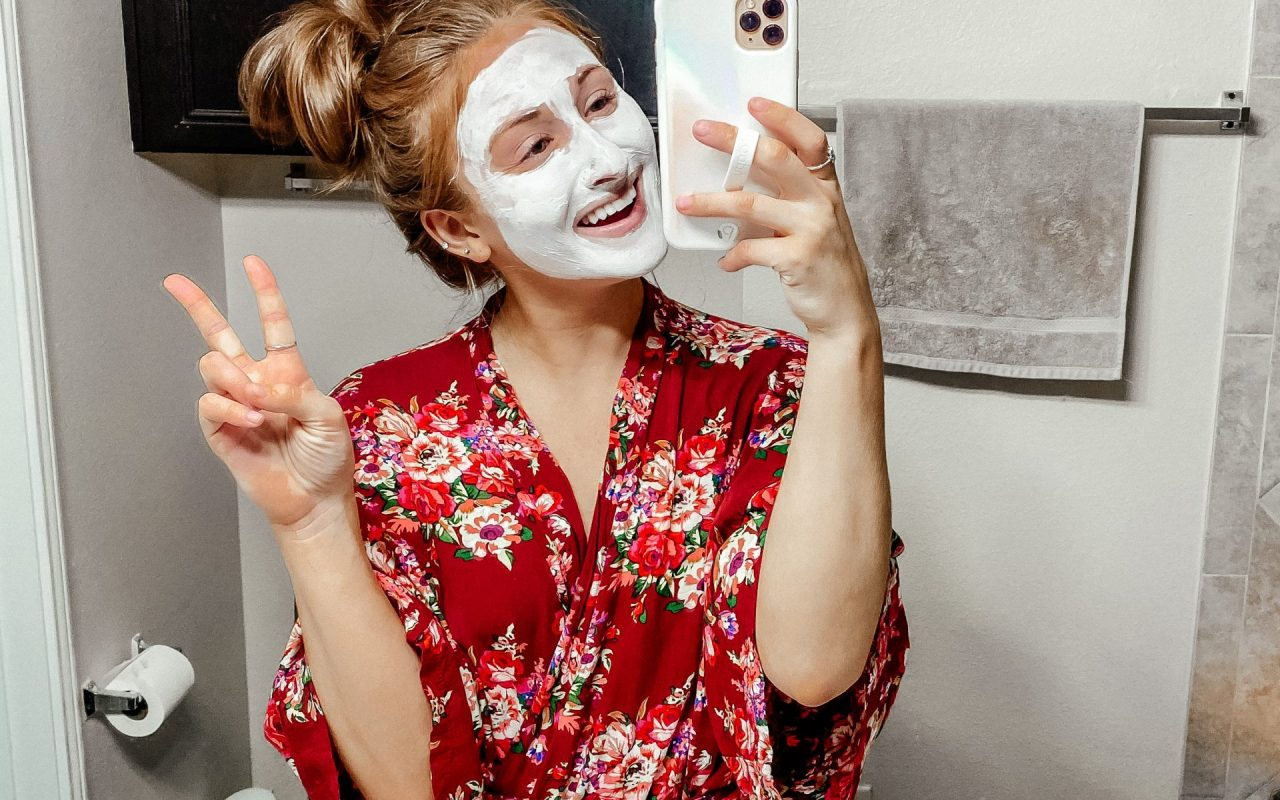 Applying a face mask for dry skin in the winter time.