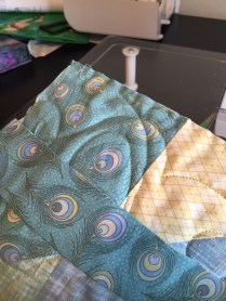 2. I use four-inch-wide strips pressed in half, right sides out. You can decide how wide or narrow you prefer. I figure out how many inches I need for the total quilt and add 6 to be sure then I sew it into one 1 long strip and press.
