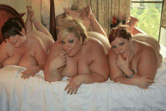 three fat chicks on a bed