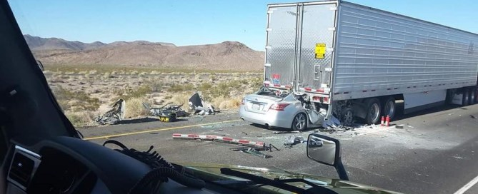 Texting Driver Rear Ends semi truck on highway