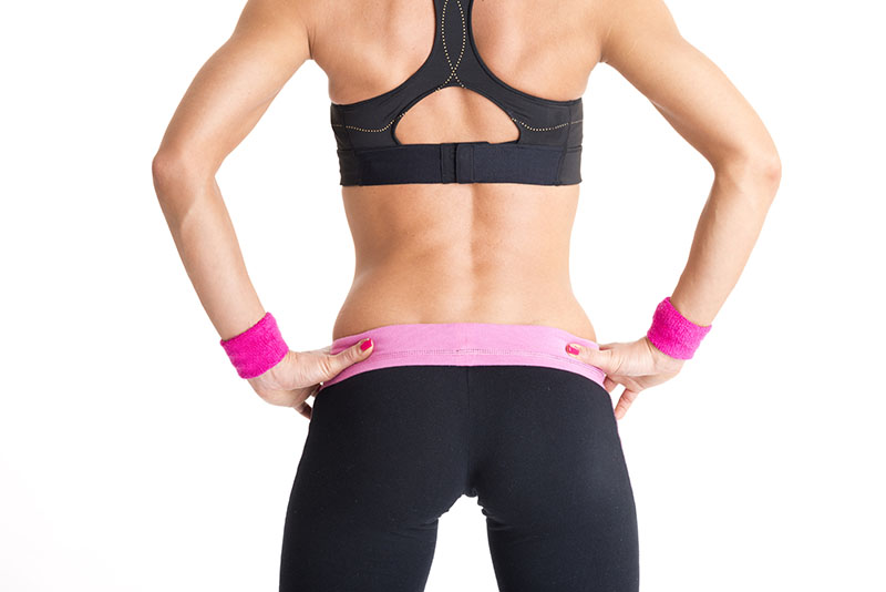 Fitness woman doing exercises on white background
