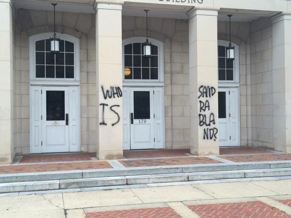 """Who is Sandra Bland?"" Spray Painted on Silent Sam and Post Office"