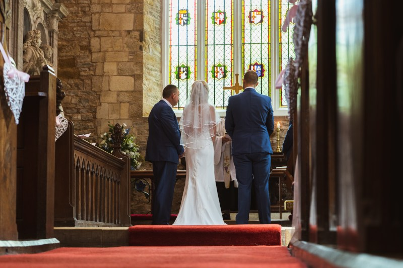 A bride and groom say their vows at a Church Wedding Ceremony.