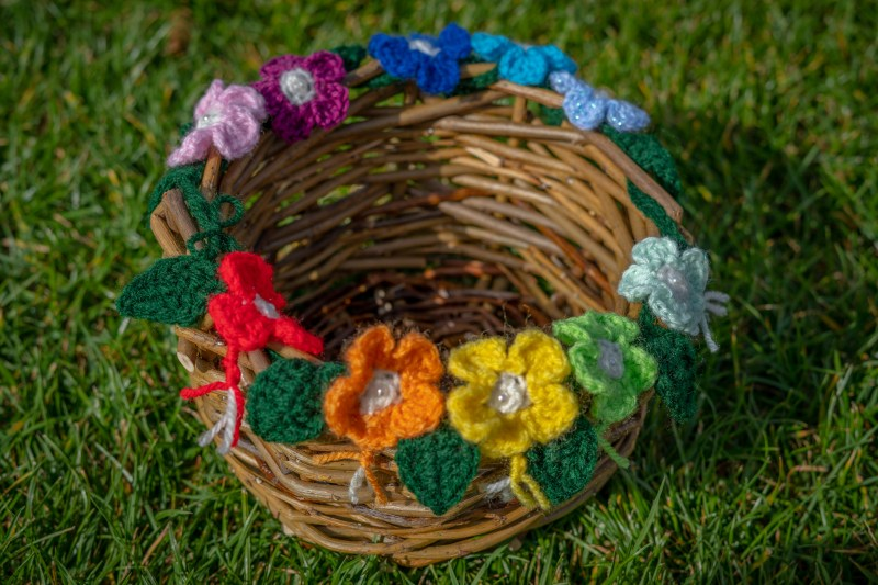 An incredible wicker basket with crocheted flowers made by Penny James.