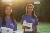 Student Council Representatives Jamie Chong (10) and Noreen Ali (10) hand out donuts at the Front Office.