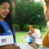 Student Council Representative Jamie Chong (10) hands out a donut to Ashley Terry (11) at the Front Office.