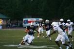 Running back William Caylor (22) dodges a member of Lakeside's defensive line.