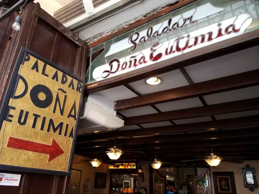 The entrance to Doña Eutimia can be well recognized when you see the yellow sign with black letters - Dona Eutimia - and a large red arrow pointing the way inside the restaurant. Don't be mislead by people who will try to steer you toward their restaurants instead. Make sure you enter at the yellow sign.