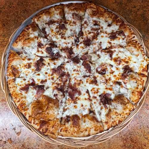 CHICKEN BACON RANCH - Our homemade dough lightly covered with white sauce, smothered with ranch dressing, topped with chicken, bacon, and mozzarella cheese.