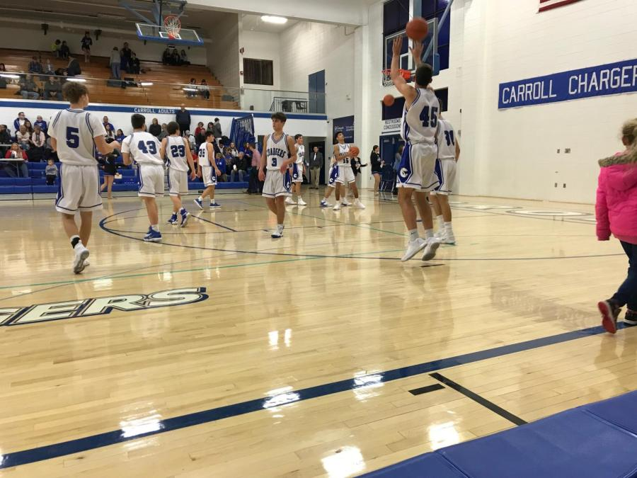The+JV+Basketball+team+warms+up+at+halftime+during+an+January+2018+game.+Junior+Varsity+playing+time+can+give+athletes+the+chance+to+get+better+and+become+strong+enough+to+play+varsity.+Photo+by+Nol+Beckley
