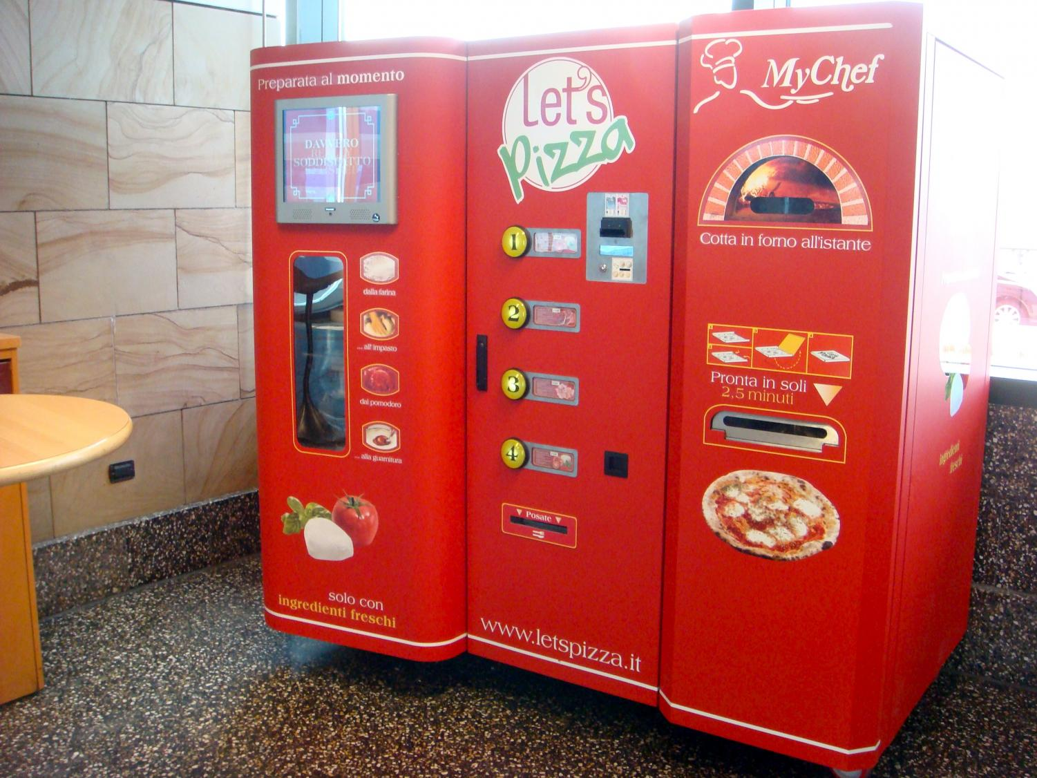 In Milan, Italy, people can purchase pizza directed though an automated pizza maker.  Photo from Creative Commons.