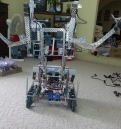 this robot employs two forks that lift large balls onto the catapult this catapult has the capabilities of launching 8 9 large balls  [ 1066 x 800 Pixel ]