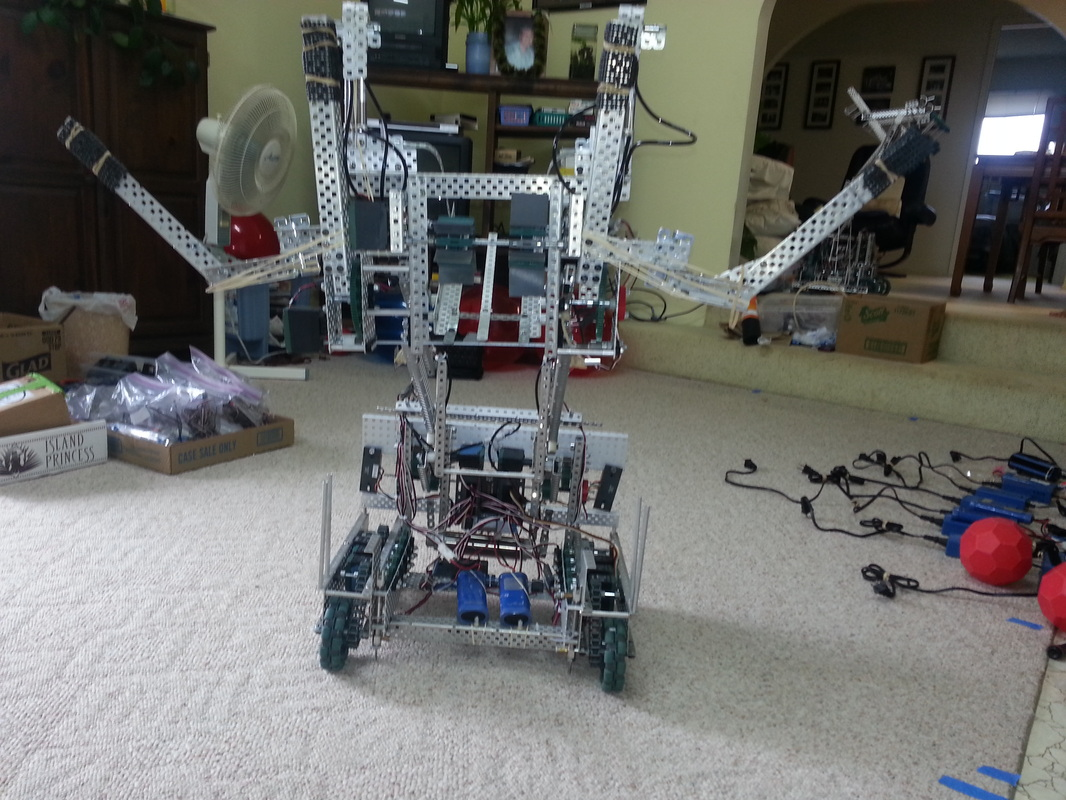 hight resolution of this robot employs two forks that lift large balls onto the catapult this catapult has the capabilities of launching 8 9 large balls
