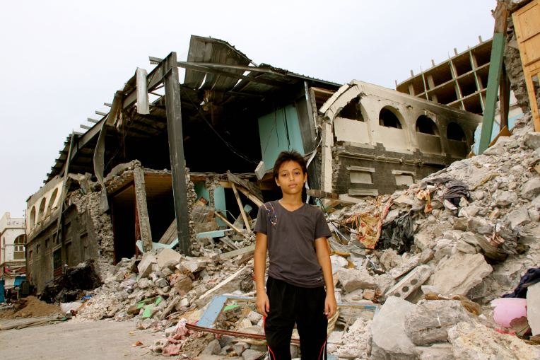 Yihab Al Tayeb next to his house destroyed on April 27, Al Kateea, Crater