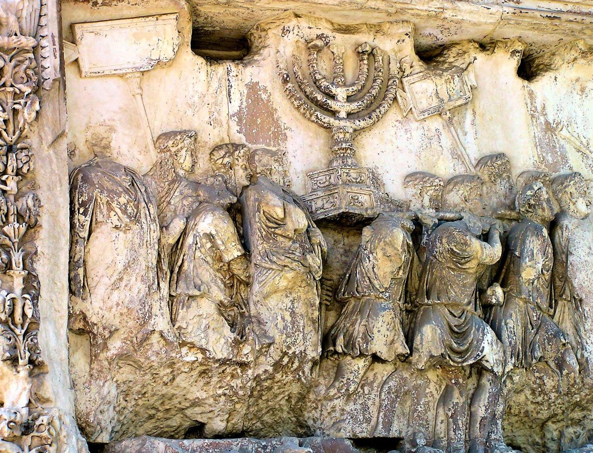 Bas Relief: The Triumphal Arch in Rome depicting the removal of Temple treasures following Titus' victory in Jerusalem in AD 70.