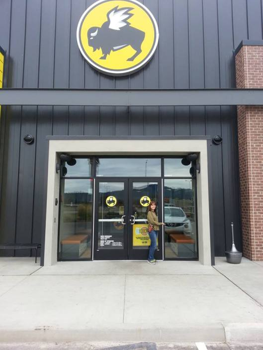 Tina standing in front of BWW after they have removed the sign.