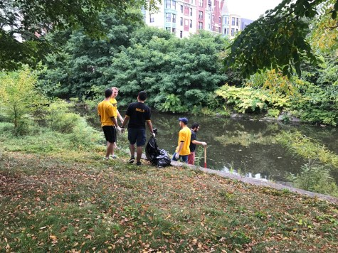 Members of the Phi Kappa Sigma fraternity at MIT cleaning up Charlesgate Park