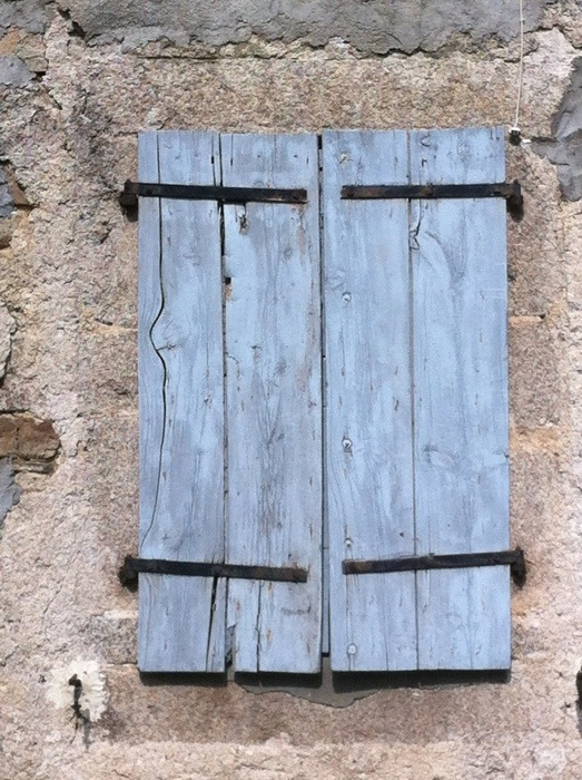 Shuttered window in Bigose between Les Faux and Aumont Aubrac on The way of St James, France, Photographed by Charles Hawes, Route St Jacques, GR65.