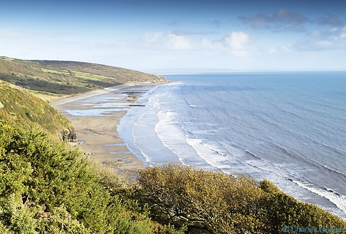 Bay near Telpyn Point photographed from the Wales Coast Path between St Clears and Amroth by Charles Hawes. Walking in Wales.