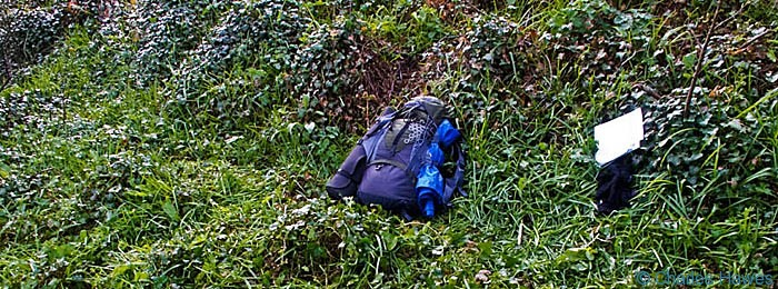 Packed rucksack on the Wales Coast Path in Pembrokeshire, photographed by Charles Hawes