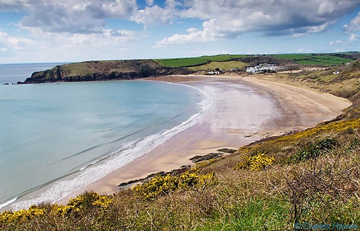 View of the bay at Freshwater East on the Wales Coast Path in Pembrokeshire, photographed by Charles Hawes