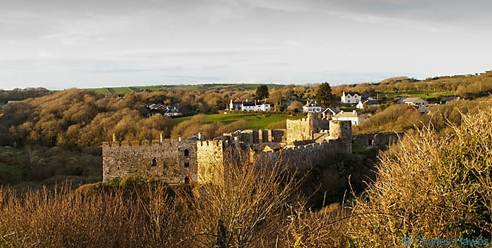 View of Manorbier Castle from the Wales Coast path, Pembrokeshire. Image by Charles Hawes.