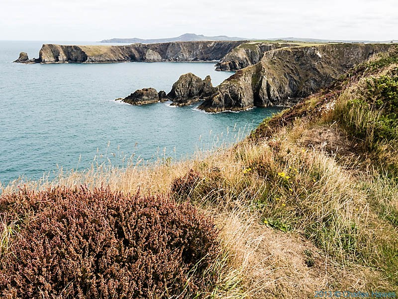 View to Pen Castell -coch from near Trefin photographed from The Wales Coast Path by Charles Hawes