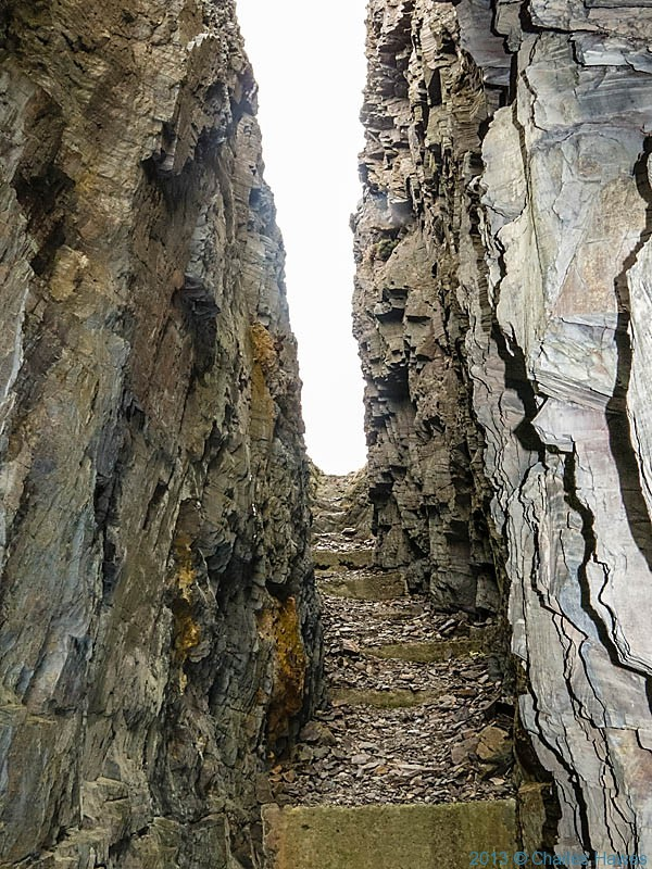 Cleft in The cliff face near Pwll Deri near the Wales Coast Path, photographed by Charles Hawes