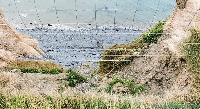 Collapsed cliff edge near the Wales Coast Path in Ceredigion, photographed by Charles Hawes