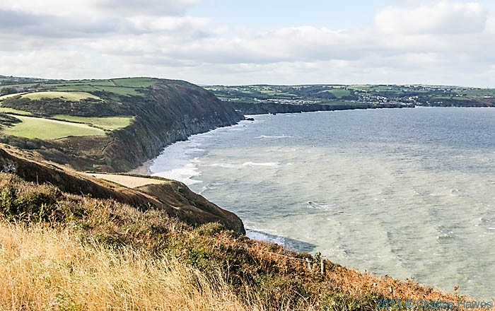 View looking south from above Penbryn to Aberporth, photographed from The wales Coast path by Charles Hawes