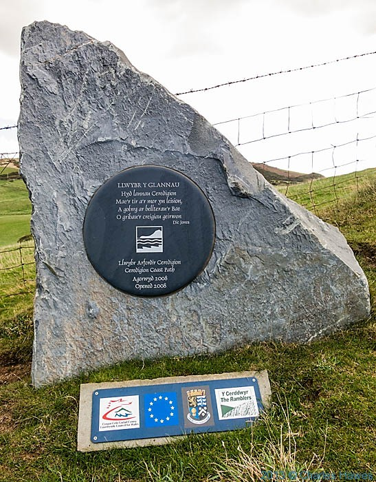 Slate plaque at Urdd, Ceredigion,commemorating the opening of the next section of the Walaes Coast Path, photographed by Charles Hawes