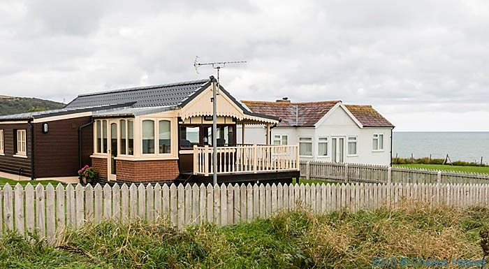 Converted railway carriage on the outskirts of Aberporth, photographed from The Wales Coast Path by Charles Hawes