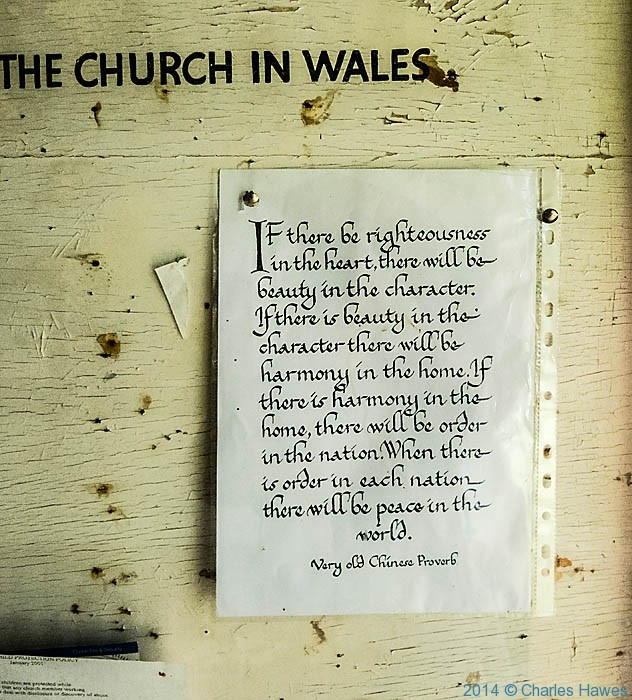 Notice board of the churdch of St Michael, Ynys, photographed by Charles Hawes'