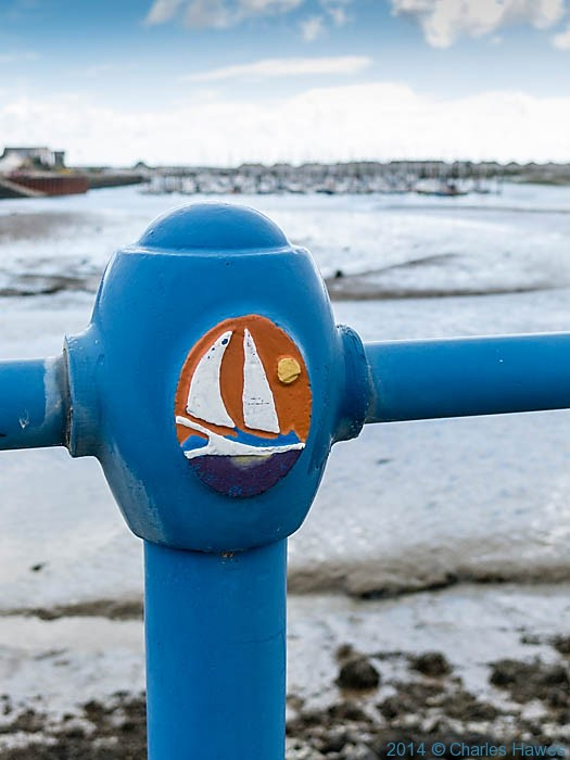 Railings at Pwllheli marina photographed from The Wales Coast Path by Charles Hawes