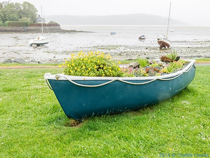 Planted boat on the harbourside at Borth-y-Gest on the Lleyn peninsula, photographed from The Wales Coast Path by Charles Hawes