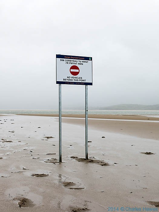 Warning sign on Black Rock Sands on the Lleyn peninsula, photographed from The Wales Coast Path by Charles Hawes